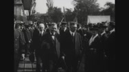 Josephus Daniels and Albert Cushing Read walking with group of officials Stock Footage
