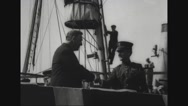 Josephus Daniels and Commander Albert Cushing Read shaking hands on deck of ship Stock Footage
