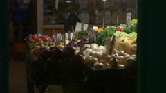 A vegetable stand selling fresh produce with onions and squash  Stock Footage