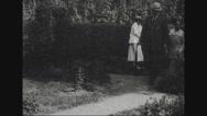 William Cox Redfield walking in the garden Stock Footage
