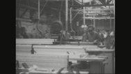 Workers cutting wooden planks in factory Stock Footage