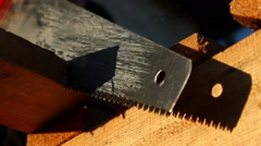 Builder with handsaw - stock footage