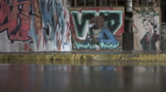 Raining inside a graffited industrial building Stock Footage