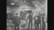 Workers assembling aircraft wings on the aircraft Stock Footage
