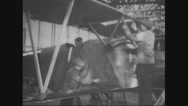Workers attaching aircraft wings on the aircraft Stock Footage