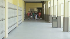 Slow Motion Sequence Of School Students Running In Hallway - stock footage