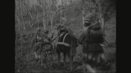 Military soldiers walking with mules Stock Footage