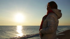 Woman on sea with smartphone Stock Footage