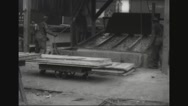 Lumberjacks placing wood panels in water Stock Footage