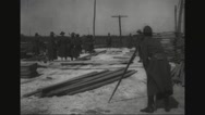 Lumber being unloaded on French port Stock Footage