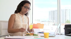 Woman Working In Design Studio Having Lunch At Desk Stock Footage