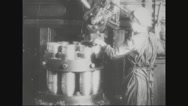 Worker cleaning missile shells rotating in machine Stock Footage