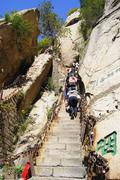 People climbing upstairs to Mount Huashan Stock Photos