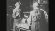 Workers tightening the metal casing in lathe machine Stock Footage
