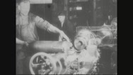 Worker placing the missile shell in lathe machine Stock Footage