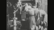 Workers working in ammunition factory Stock Footage