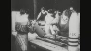 Workers painting the metal casing of missile Stock Footage