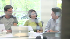 View Of Business Meeting In Design Office Through Window Stock Footage