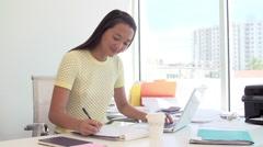 Businessman And Businesswoman Working In Design Studio Stock Footage