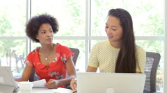 Two Women Working Together In Design Studio Stock Footage