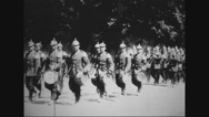 Military band and troops of soldiers marching in rows Stock Footage