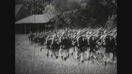 Troops of soldiers marching through forest Stock Footage