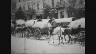 Soldiers entering town with supply wagons Stock Footage
