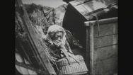 Old woman hiding between ruins Stock Footage