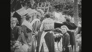 Refugees waiting with their belongings Stock Footage