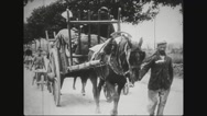 Refugees pushing wheelbarrows with luggage Stock Footage