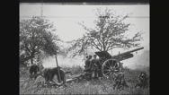 Soldiers loading howitzer Stock Footage