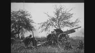 Soldiers loading and firing howitzer Stock Footage