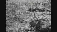 Military soldiers inspecting dead bodies in rubble Stock Footage