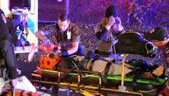 Ambulance crew loading female patient with head trauma into ambulance - stock footage