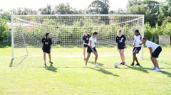 Slow Motion Sequence Of Female School Soccer Team Training Stock Footage