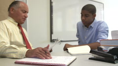 Male Student Talking To High School Counselor - stock footage