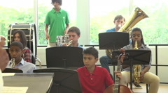 Pupils Playing Musical Instruments In School Orchestra Stock Footage