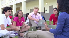 High School Students And Teacher Studying Outdoors On Campus Stock Footage