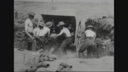 Military soldiers loading tank to fire Stock Footage