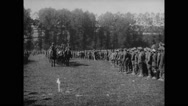 Military soldiers and officers watching horse parade Stock Footage