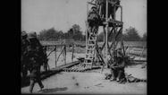 Military soldier climbing down steps of lookout tower Stock Footage