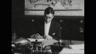 Secretary Newton Diehl Baker working in office Stock Footage