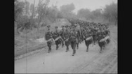 Military soldiers marching with military band Stock Footage