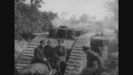 Military soldiers sitting on tank Stock Footage