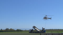 Helicopter and fertilizer bucket lift off Stock Footage