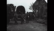 Military soldiers unloading boxed from covered wagon Stock Footage