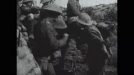 View of bomb explosions and soldiers running out of trench Stock Footage