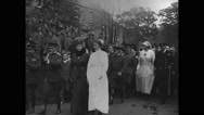 King George and Queen Mary walking with officers Stock Footage