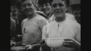 Prisoners holding bowls and drinking Stock Footage