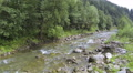 Flight over small mountain river . Aerial  HD Footage
